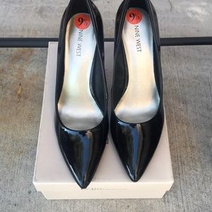 Never worn black patent leather pumps